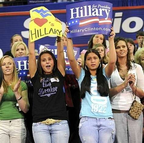 Supporters of Democratic presidential hopeful Sen. Hillary Rodham Clinton, D-N.Y., hold up signs and cheer at a rally for Clinton on Monday, May 12, 2008, in Logan, W.Va. Photo: Michael Browning, AP / AP