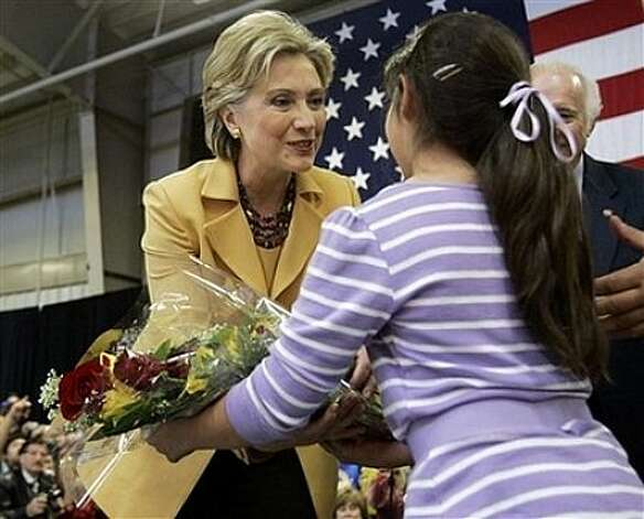 Democratic presidential hopeful, Sen. Hillary Rodham Clinton, D-N.Y., accepts flowers from Rachelle Shamsie, 9, during a campaign stop at the Richard M. Borchard Regional Fairgrounds in Robstown, Texas, Wednesday, Feb. 13, 2008. Photo: Carolyn Kaster, AP / AP