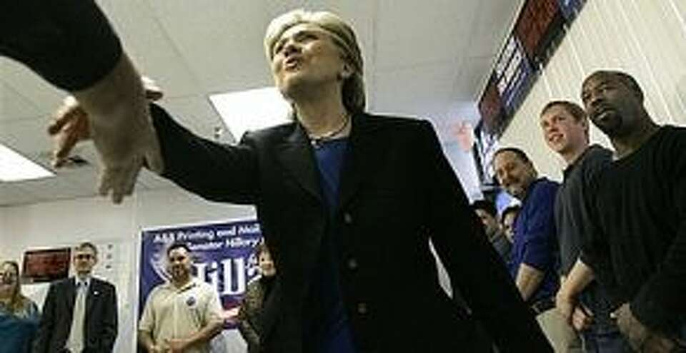 Democratic presidential hopeful Sen. Hillary Rodham Clinton, D-N.Y. shakes a hand at A&B Printing Co