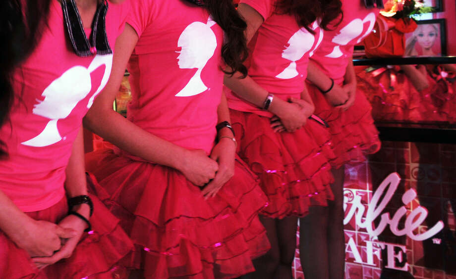 Waitresses stand in their uniforms during the opening ceremony of a Barbie-themed restaurant in Taipei on January 30, 2013. Photo: SAM YEH, AFP/Getty Images / 2013 AFP