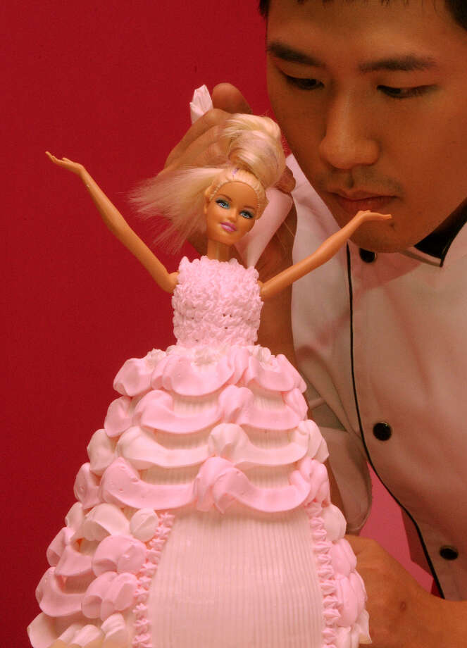 A chef makes a Barbie doll themed cake. Photo: SAM YEH, AFP/Getty Images / 2013 AFP