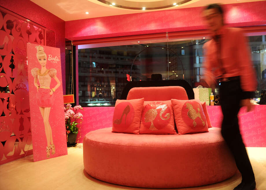 A staff member walks past the hot pink sofas. Photo: SAM YEH, AFP/Getty Images / 2013 AFP