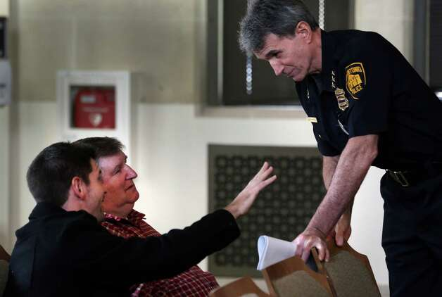 San Antonio Police Chief William McManus, right, talks with Michael DeLoach, left, and his father John DeLoach, both of Bexar Towing, following City Council's vote which passed an ordinance that will raise how much towing companies can charge to haul away vehicles illegally parked on private property. Thursday, Jan. 31, 2013 Photo: Bob Owen, San Antonio Express-News / © 2012 San Antonio Express-News