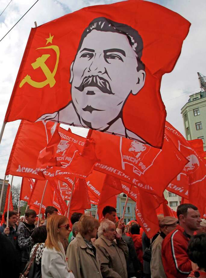 FILE - In this May 1, 2012 file photo, Communist Party supporters march with their flags during a rally to mark May Day in Moscow, Russia. The southern Russian city where the Red Army decisively turned back Nazi forces in a key World War II battle will once again be known as Stalingrad, at least on the days commemorating the victory.The city was renamed Volgograd in 1961 as part of the Soviet Union's rejection of dictator Joseph Stalin's personality cult. But the name Stalingrad is inseparable with the battle, in which at least 1.25 million people died. Russia on Saturday plans extensive ceremonies to mark the 70th anniversary of the battle's end. (AP Photo/Mikhail Metzel, File) Photo: Mikhail Metzel, STF / AP