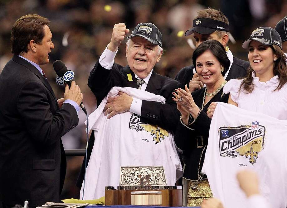 Team owner Tom Benson (C) of the New Orleans Saints, his wife Gayle (2nd R) and daughter Rita Benson LeBlanc (R) celebrate with the George S. Halas Trophy after the Saints won 31-28 in overtime against the Minnesota Vikings during the NFC Championship Game at the Louisiana Superdome on January 24, 2010 in New Orleans, Louisiana. Photo: Jed Jacobsohn, Getty Images / 2010 Getty Images