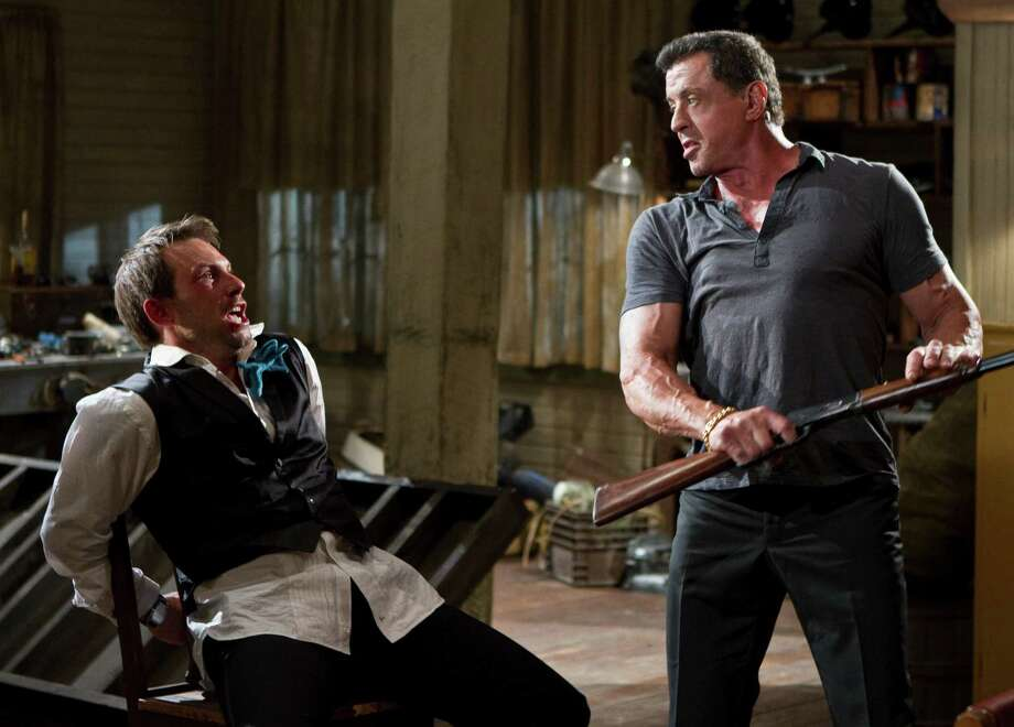 "This film image released by Warner Bros. Pictures shows Christian Slater, left, and Sylvester Stallone in a scene from ""Bullet to the Head."" (AP Photo/Warner Bros. Pictures, Frank Masi) Photo: Frank Masi"