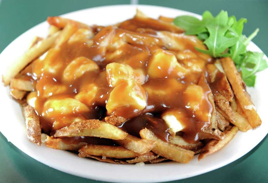 Classic Poutine with fresh-cut fries, cheddar cheese curds and Montreal-style gravy on Tuesday, Jan. 29, 2013, at Shirley's Cafe in Jonesville, N.Y. (Cindy Schultz / Times Union) Photo: Cindy Schultz / 00020936A