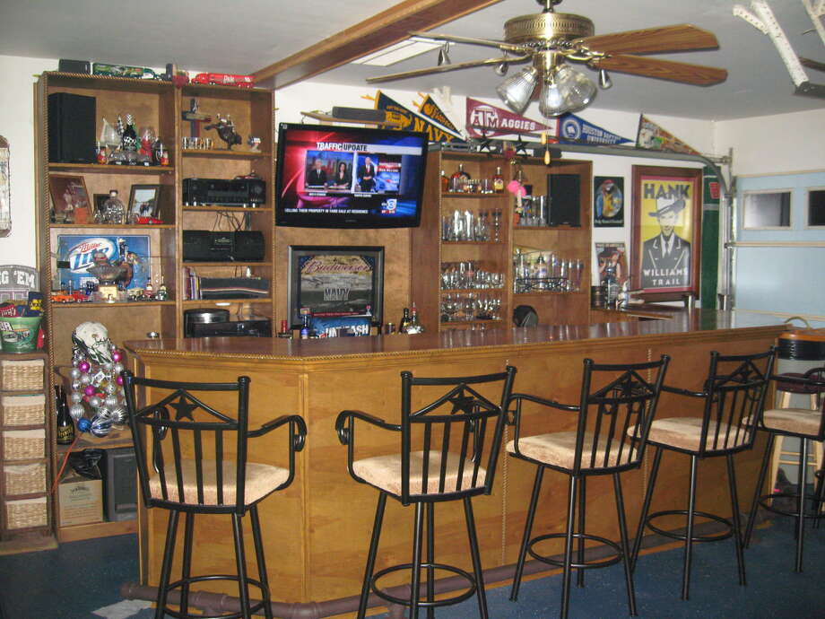 These decked-out man caves are suitable for any football fan.  Photo: Courtesy Of Ellis Spangler