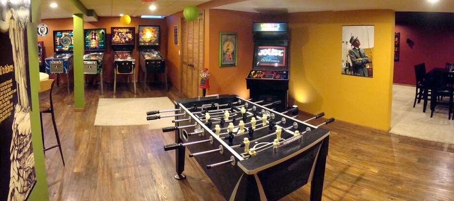 These decked-out man caves are suitable for any football fan. Photo: Courtesy Of Matthew Landry