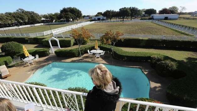 "Shown in this photo made Tuesday, Nov. 13, 2012, is the backyard pool of the mansion at Southfork Ranch made famous by the Dallas TV  show in Parker, Texas. Tourists have been flocking to Southfork Ranch since the early years of the classic series, which ran from 1978 to 1991. And a new ""Dallas"" starting its second season on TNT on Monday and the recent death of the show's star, Larry Hagman, who legendarily played conniving Texas oilman J.R. Ewing, have also spurred fans to visit. (AP Photo/LM Otero) Photo: LM Otero"