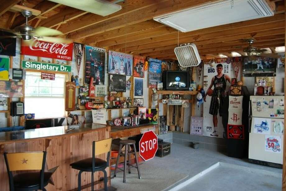 These decked-out man caves are suitable for any football fan.  Photo: Courtesy Of John Singletary