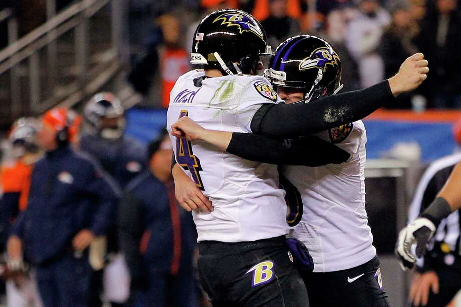 Sam Koch #4 and Justin Tucker #9 of the Baltimore Ravens celebrate after Tucker kicked a successful game-winning 47-yard field goal in the second overtime against the Denver Broncos during the AFC Divisional Playoff Game at Sports Authority Field at Mile High on January 12, 2013 in Denver, Colorado. The Ravens won 38-35. Photo: Doug Pensinger, Getty Images / 2013 Getty Images