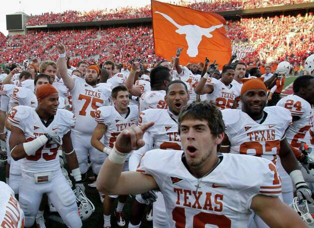 Texas players, including Justin Tucker, foreground, celebrate their 20-13 win over No. 5 Nebraska in an NCAA college football game in Lincoln, Neb., Saturday, Oct. 16, 2010. (AP Photo/Nati Harnik) Photo: Nati Harnik, Associated Press