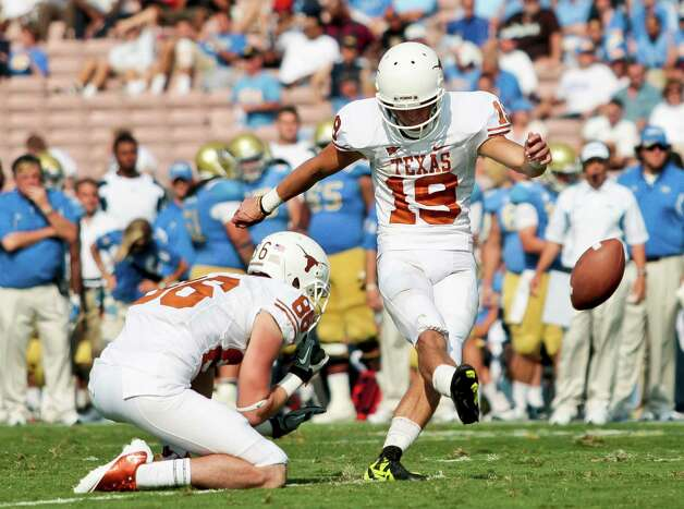 Texas kicker Justin Tucker (19) kicks an extra point during the second half of an NCAA college football game against UCLA, Saturday, Sept. 17, 2011, at the Rose Bowl in Pasadena, Calif. Texas won 49-20. (AP Photo/Bret Hartman) Photo: BRET HARTMAN, Associated Press / FR139655 AP