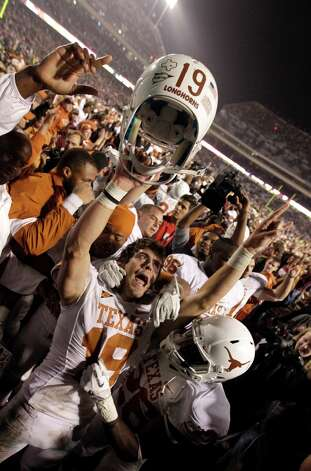 Texas kicker Justin Tucker (19) celebrates with teammates after kicking the game-winning field to beat Texas A&M in an NCAA college football game Thursday, Nov. 24, 2011, in College Station, Texas. Texas beat Texas A&M 27-25. (AP Photo/David J. Phillip) Photo: David J. Phillip, Associated Press / AP