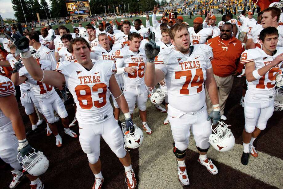 Texas tight end Greg Smith (83) joins offensive tackle Adam Ulatoski (74) and punter Justin Tucker (19) in leading teammates in singing after a 41-10 victory over Wyoming in an NCAA college football game in Laramie, Wyo., on Saturday, Sept. 12, 2009. (AP Photo/David Zalubowski) Photo: David Zalubowski, Associated Press / AP