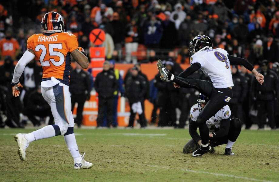 Baltimore Ravens kicker Justin Tucker (9) kicks the game winning field goal as Baltimore Ravens punter Sam Koch (4) holds against the Denver Broncos in overtime of an AFC divisional playoff NFL football game, Saturday, Jan. 12, 2013, in Denver. The Ravens won 38-35. Left is Denver Broncos cornerback Chris Harris. (AP Photo/Jack Dempsey) Photo: Jack Dempsey, Associated Press / FR42408 AP