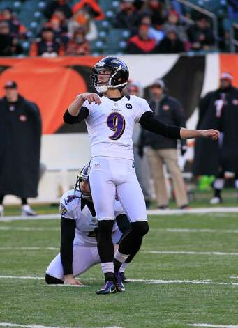 Baltimore Ravens kicker Justin Tucker (9) kicks a field goal against the Cincinnati Bengals in an NFL football game, Sunday, Dec. 30, 2012, in Cincinnati. (AP Photo/Tom Uhlman) Photo: Tom Uhlman, Associated Press / FR31154 AP