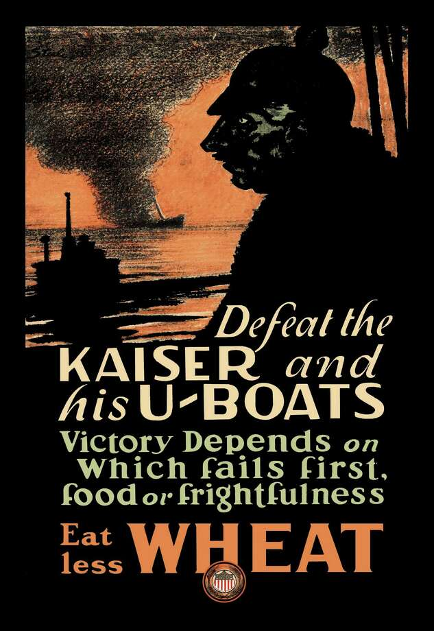 "A U.S. propaganda poster from World War I proclaims: ""Defeat the Kaiser and His U-Boats - Eat Less Wheat."" Photo: Buyenlarge, Getty Images / Archive Photos"