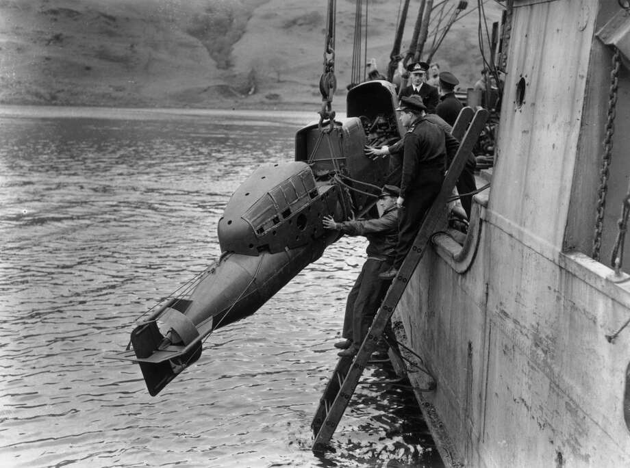 "The British Royal Navy tests a ""human torpedo"" on May 15, 1944. It carried explosives to attack enemy ships. Once in range, the two crew members would eject and wait to be rescued. Photo: J. Wilds, Getty Images / Hulton Archive"
