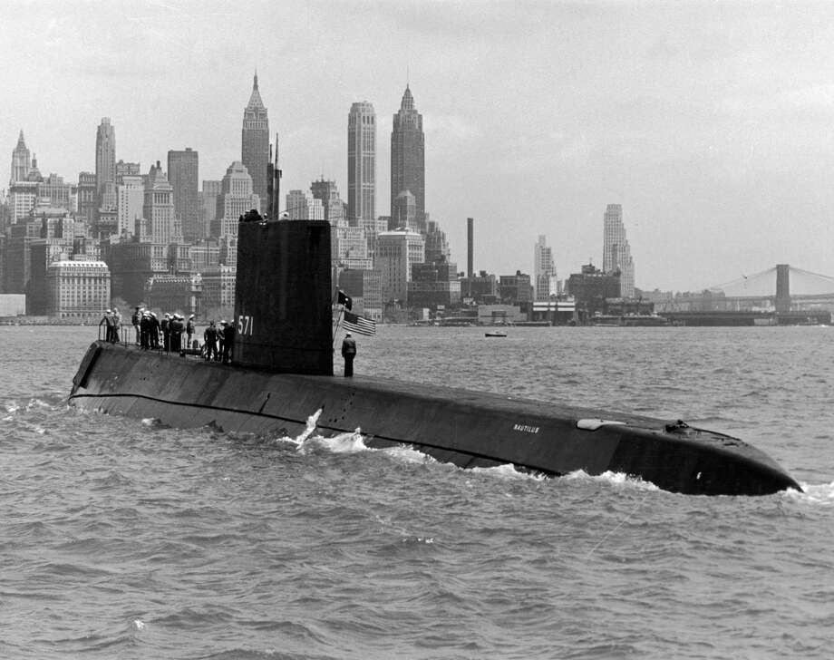 The USS Nautilus, the world's first nuclear-powered submarine, enters New York Harbor during routine training operations in May 1956. Photo: Hulton Archive, Getty Images / Archive Photos