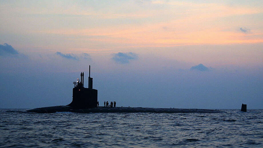 The new U.S. nuclear-powered attack submarine Virginia travels from Norfolk, Va., Naval Shipyard to complete sea trials on Aug. 25, 2004. It was designed with the post-Cold War security environment in mind. Photo: AFP, AFP/Getty Images / 2004 AFP