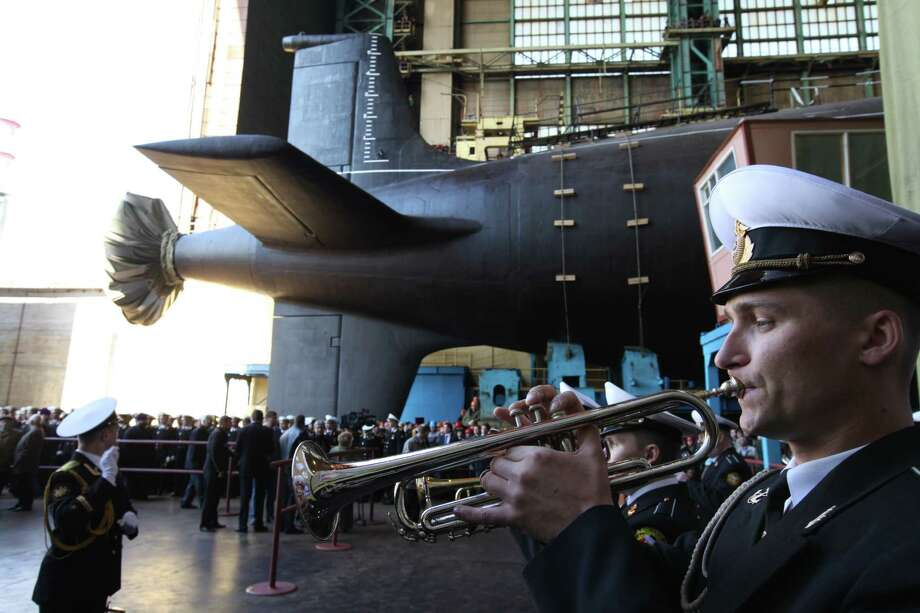 A Russian military orchestra plays during a ceremony to launch the multipurpose nuclear submarine Severodvinsk at the Sevmash shipyard on June 15, 2010. Photo: Sasha Mordovets, Getty Images / 2010 Sasha Mordovets
