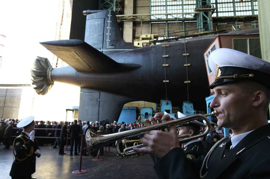 A Russian military orchestra plays during a ceremony to launch the multipurpose nuclear submarine Se