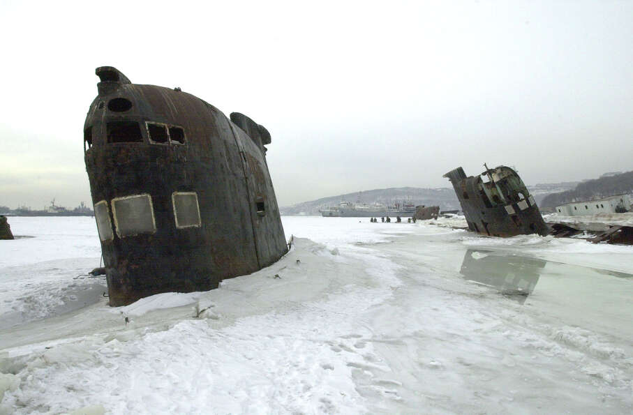 Abandoned Russian submarines lie stuck in the ice where they sunk Jan. 28, 2001 in Vladivostok, Russ