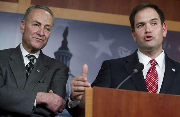 Sen. Marco Rubio, R-Fla. (right), speaks alongside Sen. Chuck Schumer, D-N.Y.,  during a press conference on immigration reform. Photo: Getty Images / AFP