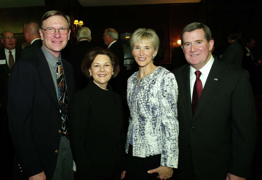 OTS/HEIDBRINK - Trinity University alumni association president Dave Mansen, from left, sponsor Barbara Gentry, spouse Carla Bergner and honoree  U.S. Army Maj. Gen (retired) Kevin Bergner gather at the  Distinguished Alumni reception at Trinity University on 1/25/2013. This is #1 of 2 photos. names checked photo by leland a. outz Photo: LELAND A. OUTZ, SPECIAL TO THE EXPRESS-NEWS / SAN ANTONIO EXPRESS-NEWS