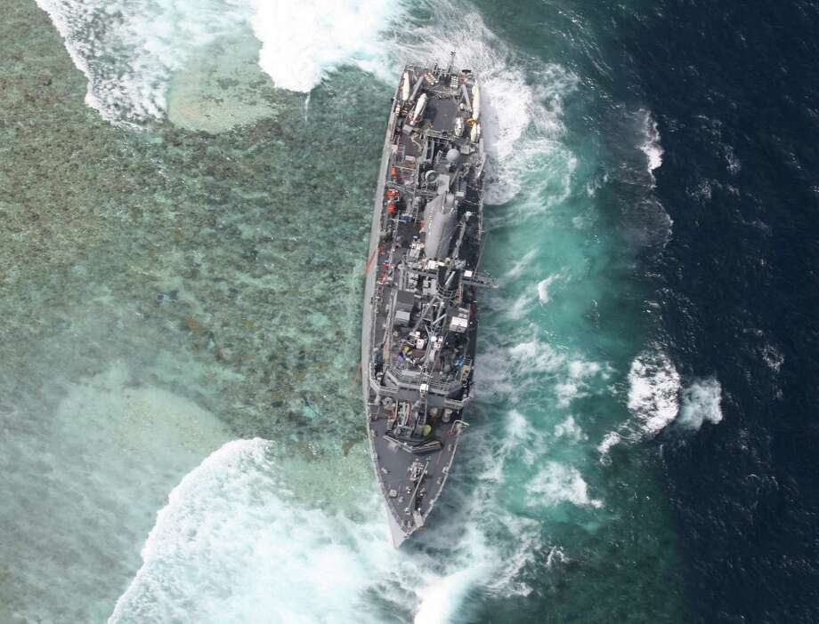 The USS Guardian is battered by waves after running aground off Tubbataha Reef in the Sulu Sea. Photo: Uncredited, HOPD / Armed Forces of the Philippines
