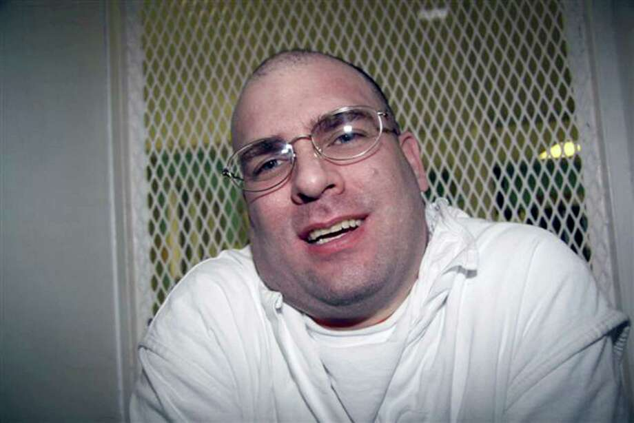 **ADVANCE FOR WEEKEND EDITIONS, JAN. 10-11**Texas death row inmate Larry Swearingen speaks from the interview cage at the death row facility in Livingston, Texas, Jan. 7, 2009. Swearingen, 37, is facing execution Jan. 27 for the strangulation of Melissa Trotter, a 19-year-old student abducted from Montgomery College north of Houston 10 years ago. Photo: Mike Graczyk, AP / AP