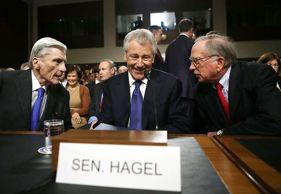 Former U.S. Sen. Chuck Hagel, R-Neb. is flanked by former U.S. Sens. John Warner, R-Va., (left) and Sam Nunn, D-Ga., at his confirmation hearing. Photo: Alex Wong, Getty Images