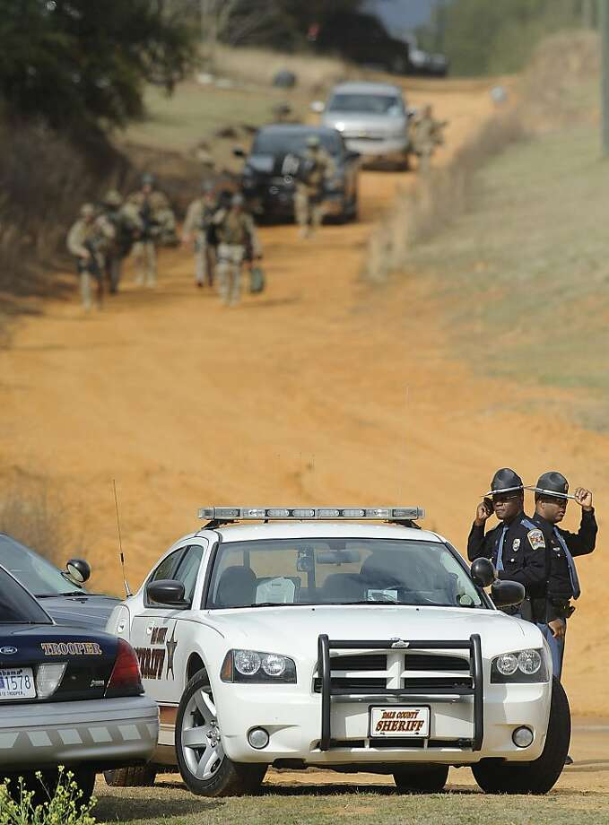 SWAT teams and hostage negotiators gather at the hostage standoff scene near Ozark, Ala., on Wednesday. As of Thursday night, there had been no break in the hostage situation. Photo: Mickey Welsh, Associated Press
