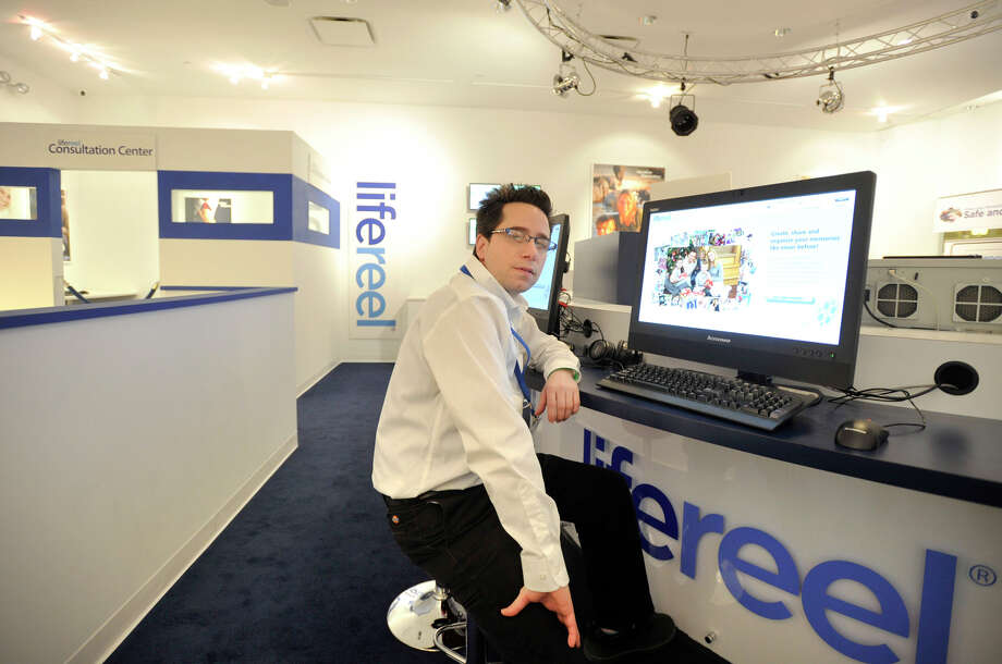 Lifereel store manager Nicolas Scandiffio sits at a work station in the company's new location at Danbury Fair mall on Thursday, Jan. 31, 2013. Photo: Jason Rearick / The News-Times