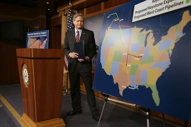 Sen. John Hoeven, R-N.D,  walks toward a illustration of the Keystone Pipeline and proposed expansions, after a news conference on Capitol Hill in Washington, Wednesday, Jan. 23, 2013. A key approval of a revised route for the Keystone XL oil pipeline from Canada to the U.S. Gulf Coast puts the long-delayed project back in the hands of the U.S. government.  (AP Photo/Jacquelyn Martin) Photo: Jacquelyn Martin, Associated Press