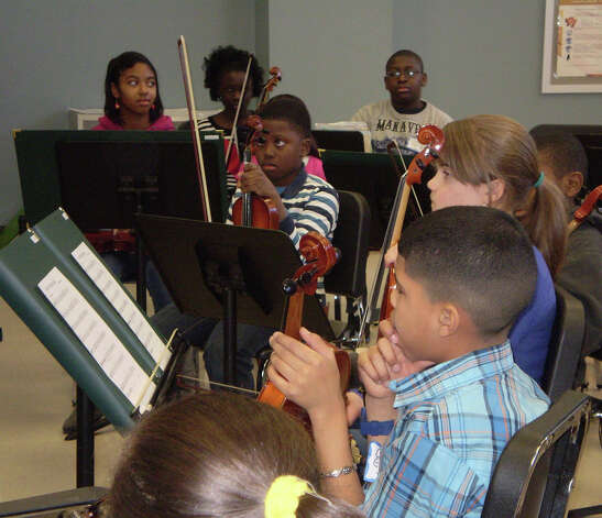 About 30 Bridgeport string students from the KEYS program are learning how to perform in an orchestra setting with the help of the Greater Bridgeport Youth Orchestras. Photo: Contributed Photo
