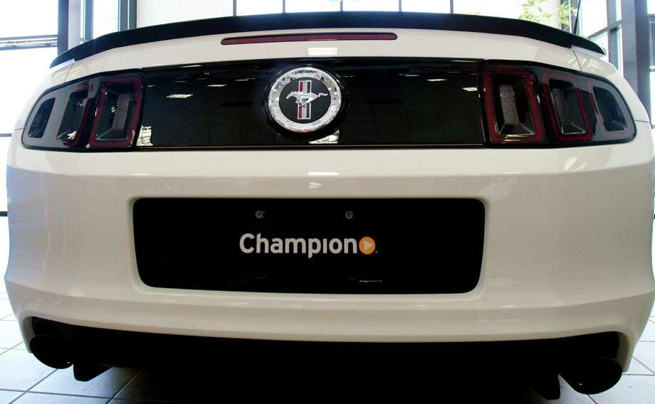 A Mustang is featured at Champion Ford, one of eight Houston-area Champion dealerships that will have the AutoNation brand. Photo: Cody Duty, Staff / © 2011 Houston Chronicle