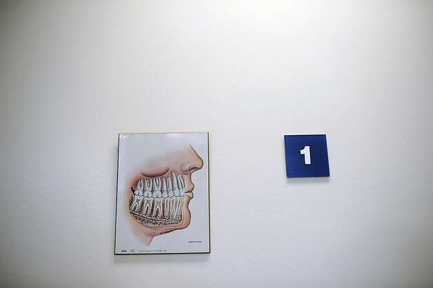 A diargam of teeth is seen on the wall in the dental clinic at SF General Hospital in San Francisco, CA Thursday January 24th, 2013. Photo: Michael Short, Special To The Chronicle