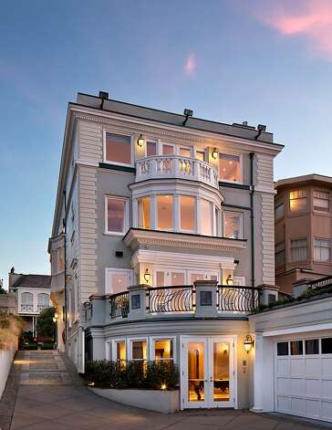 Perched on a cliff overlooking the Pacific Ocean, this home in San Francisco's Sea Cliff neighborhood is now on the market for $18.5 million. It features seven bedrooms, five full bathrooms, two half bathrooms, a media room, library, home offices and gym. There is an elevator to every level. Photo: Bernard Andre
