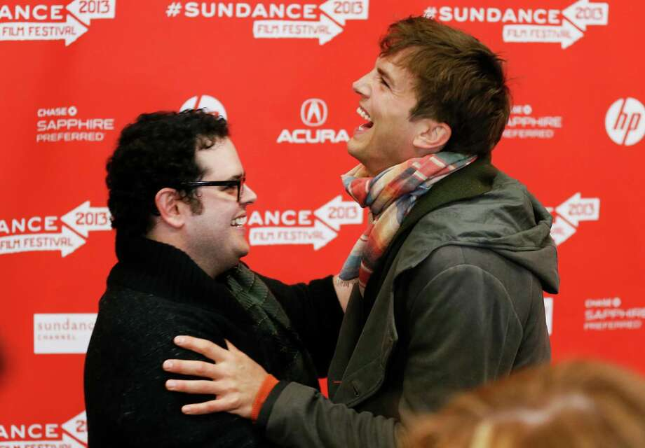 "Actors Ashton Kutcher, right, who portrays Steve Jobs, and Josh Gad, right, who portrays Steve Wozniak, left, greet each other at the premiere of ""jOBS"" during the 2013 Sundance Film Festival on Friday, Jan. 25, 2013, in Park City, Utah. (Photo by Danny Moloshok/Invision/AP) Photo: Danny Moloshok, INVL / Invision"