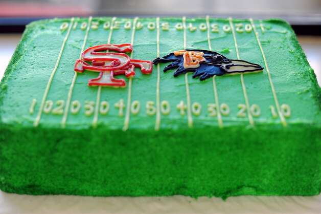 A sheet cake with 49ers and Ravens logos on a field of green icing is seen on display at Susie Cakes Bakery.  Susie Cakes Bakery on Chestnut St. has already received 400 orders for specialty 49er cakes, cupcakes and cookies, in San Francisco, CA on Wednesday January 30th, 2013.