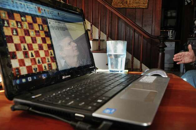 Richard Moody Jr., is reflected in the screen of his laptop at his home on Thursday, Jan. 24, 2013 in Wright, NY.   Moody says that he has a method for playing against a computer and bringing the game to a draw.   (Paul Buckowski / Times Union) Photo: Paul Buckowski