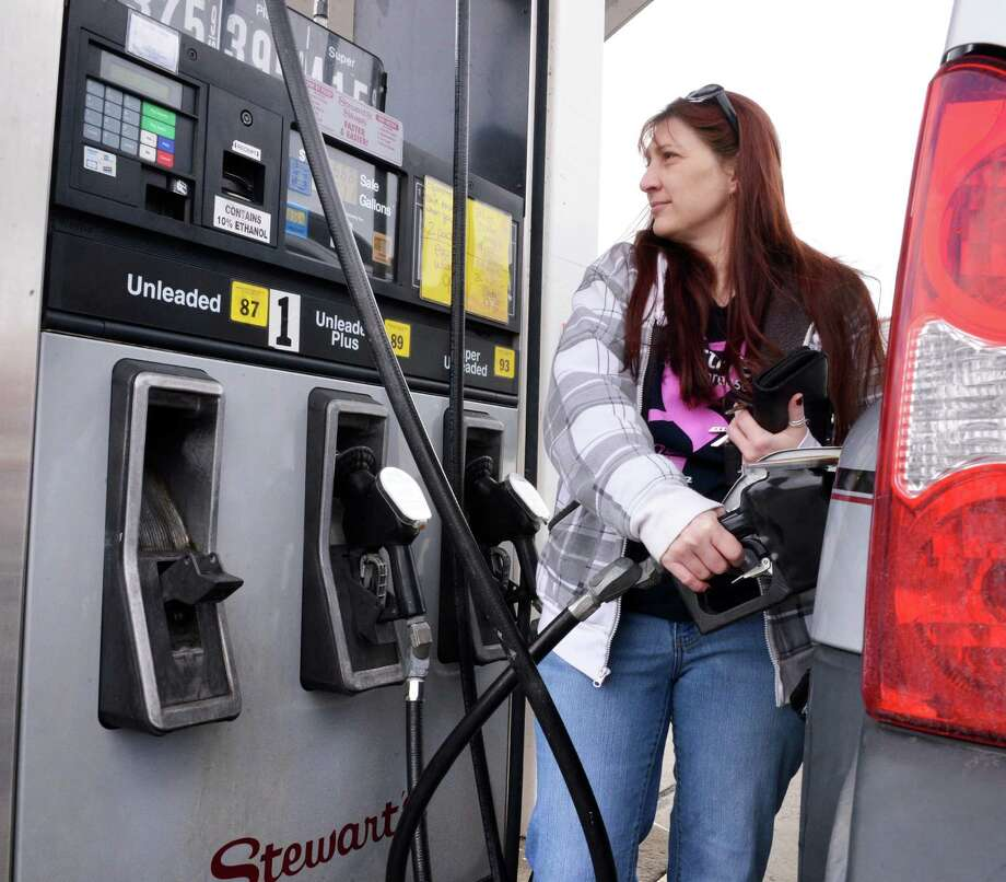Cindy Bode of Waterford pumps gas at the Stewart's Shop on Saratoga Ave. in Waterford Thursday Jan.31, 2013.  (John Carl D'Annibale / Times Union) Photo: John Carl D'Annibale