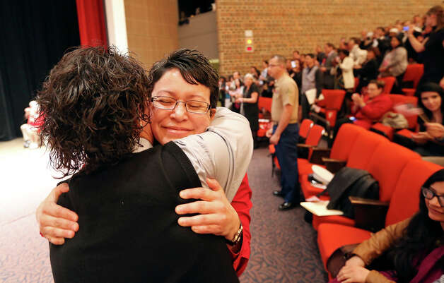 Trinity University Spanish professor Rita Urquijo-Ruiz (right) hugs Esmeralda Silva after taking her Oath of Allegiance. Photo: Edward A. Ornelas, Express-News / © 2013 San Antonio Express-News