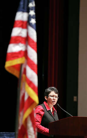 Trinity University Spanish professor Rita Urquijo-Ruiz speaks after taking the Oath of Allegiance during a citizenship ceremony held Thursday Jan. 31 2013 at Laurie Auditorium on the campus. Photo: Edward A. Ornelas, Express-News / © 2013 San Antonio Express-News