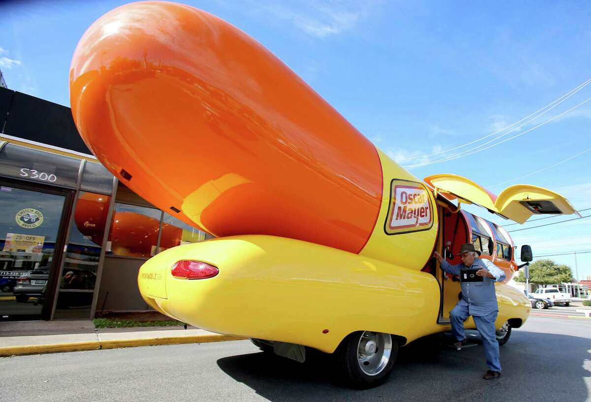 Joe Chavez, from Houston, exits the Oscar Mayer Weinermobile after taking pictures of the interior. The Vehicle was parked at Einstein Bagels on Kirby in Houston, Texas.