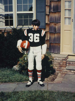 Steve Young as a 10-year-old  member of the Cowboys football team, standing in front of his parent's house in  Greenwich. Photo: Contributed Photo, GT