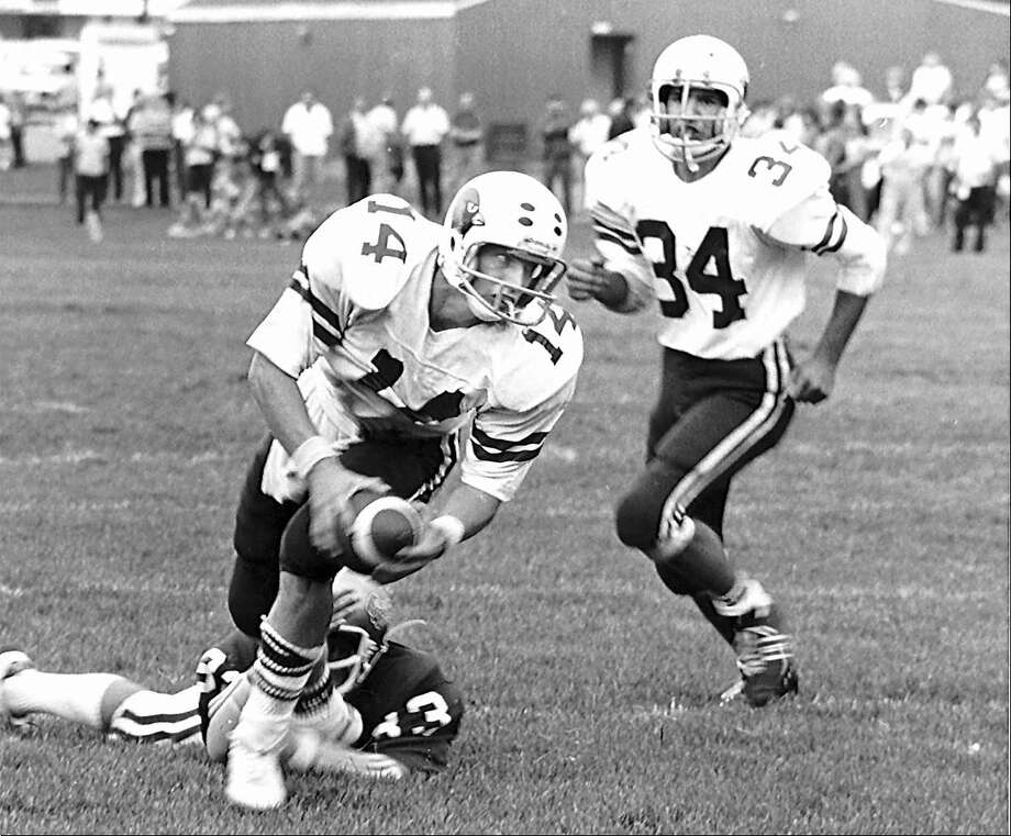 Steve Young (#14) as quarterback for Greenwich High School in a game against Norwalk High School in September 1979.